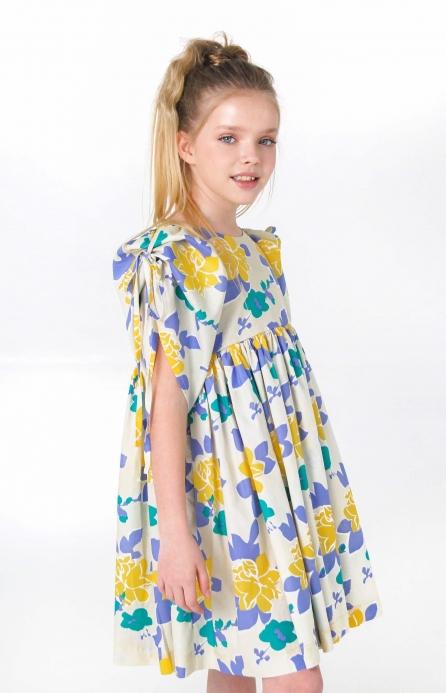 Блакитно-жовта сукня з рукавами-буфами на зав'язках
